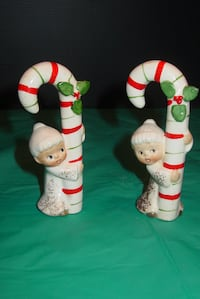 Ceramic baby angels holding candy canes. TROY