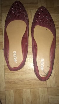 pair of brown and pink flats