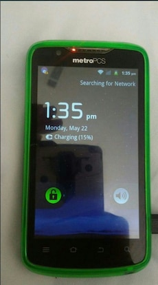black metroPCS android smartphone with green case