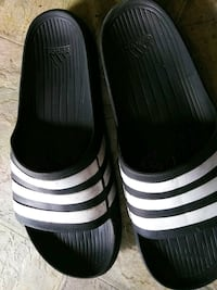 pair of black-and-white Adidas slide sandals Fresno, 93723
