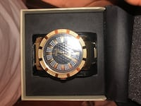 round black and gold-colored analog watch with box 2274 mi