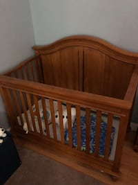 Brown wooden crib and changing table. 125 mi