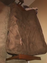Brown futon small tear