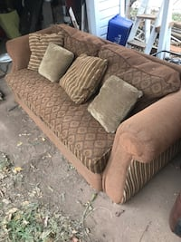 brown fabric 2-seat sofa with throw pillows