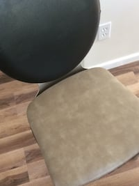 round black wooden table with black metal base Calgary, T3G