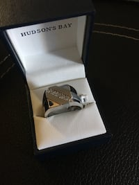 Silver diamond ring in box Vancouver, V6A 1M1