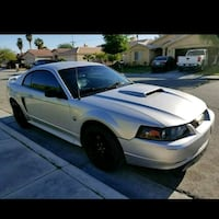 silver Ford Mustang coupe