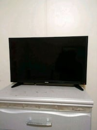 black flat screen TV with remote Detroit, 48234