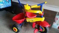 toddler's yellow and blue trike