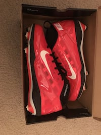 Pair of red red/orange football cleats  in box Lorton, 22079