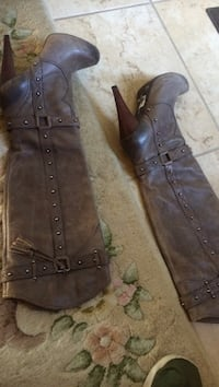 Pair of brown leather stiletto knee-high boots