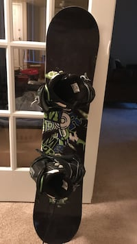 Black, white, and green snowboard with bindings Arlington Heights, 60004