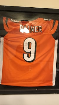 Signed Carson palmer jersey and shadow box.