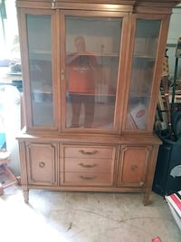 brown wooden framed glass display cabinet Pearland, 77581