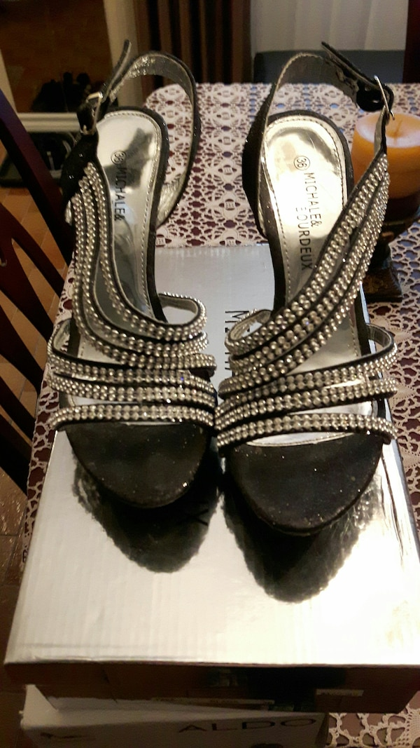 pair of rhinestone studded black suede heeled sandals