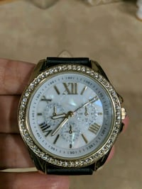 round gold-colored chronograph watch with black leather band
