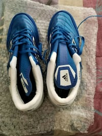 pair of blue-and-white Nike cleats Manassas