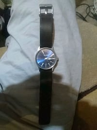 round silver analog watch with black leather strap Corpus Christi, 78410