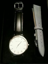 round silver analog watch with black leather strap 59 km