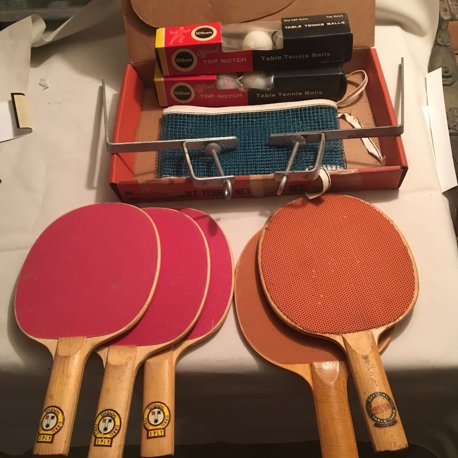Vintage table tennis equipment paddles net and balls