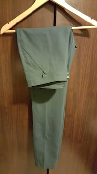 Woman's green work pants by the brand white and black  New York, 11102