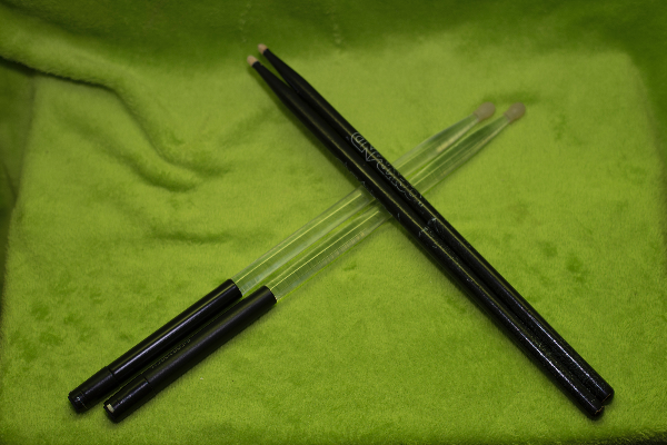 Two pairs of black and clear drum sticks