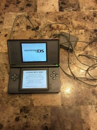 black Nintendo DS with charger Laval, H7S 1L4