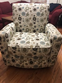 white and black floral sofa chair null