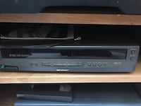 black and gray DVD player 215 mi