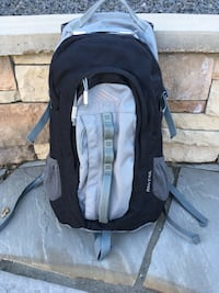 Kelty redtail backpack, black and grey, laptop or hydration pocket, hexmesh panels on back, waist belt, convenient front pockets for smaller items, mesh side pockets, and chest strap.