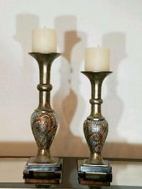 two brass-colored candle holders Arlington