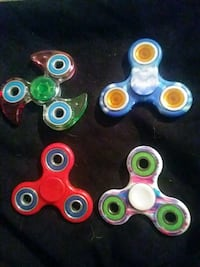 four assorted color fidget spinners