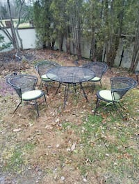 Cast Iron Patio Set (Table and 4 chairs/cushions)