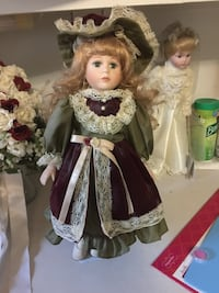 Porcelain doll in burgundy and olive green dress Alexandria, 22309