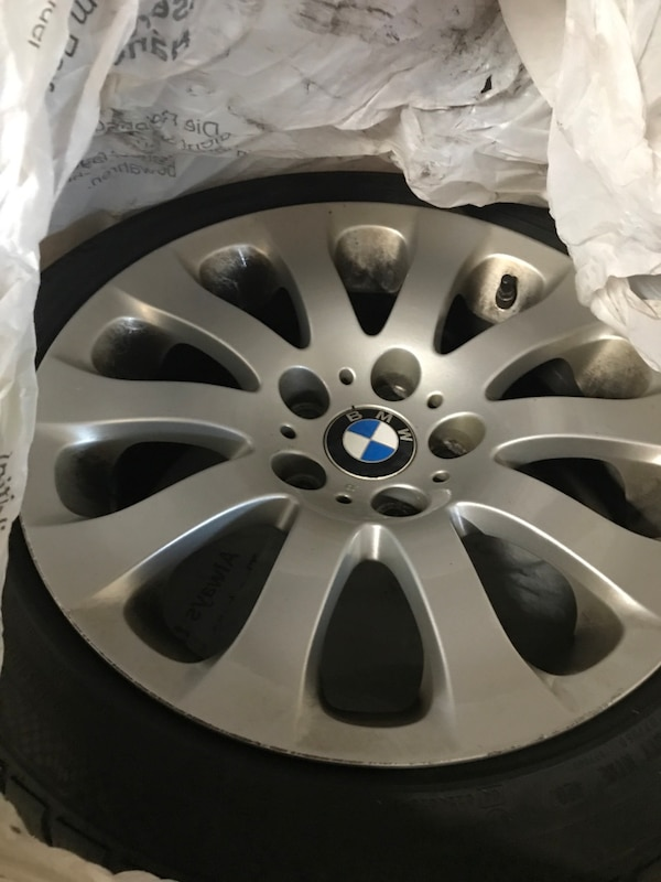 Gray bmw multi-spoke wheel with tire 19ef043f-59d7-4dfd-b6d4-93235b49116c