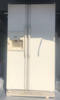 SIDE BY SIDE REFRIGERATOR HAS ALL SHELVES WORKS GOOD CAN DELIVER  Las Vegas, 89142