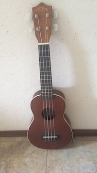 brown and black classical guitar Belleview, 34420