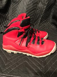 Pair of red-and-black Air Jordan shoes Little Rock, 72209