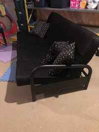 Black futon with three pillows Bradford West Gwillimbury, L3Z 0C5