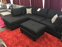 Fabric sectional with ottoman. Brand new. Reverse Option Available. Colors: Grey and Black.  Frisco, 75034