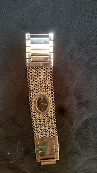oval silver-colored analog watch with link band