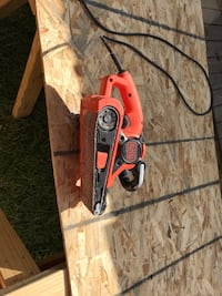 red and black corded power tool Houston, 77056