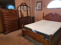 Brown wooden bed frame and white mattress 2219 mi