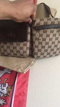 brown and black Gucci leather pouch  Toronto, M6E 1V3
