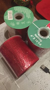 three red Netting rolls