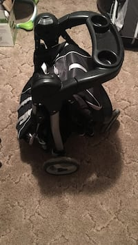 Baby's black and gray folding stroller