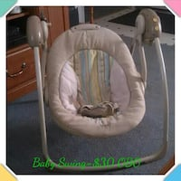 baby's white and beige portable swing