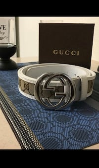 silver Gucci buckle with black leather belt 2211 mi
