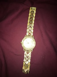 round gold analog watch with gold link bracelet Whitby, L1N 1Z8