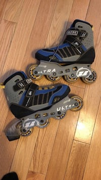 Pair of blue-and-black rollerblades/in-line skates Toronto, M4L 1M5